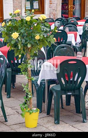 Venician patio dining - Stock Photo