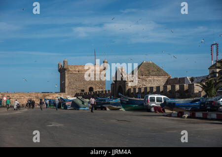 Essaouira, Morocco - May  6, 2017 : Fishing boats on background of Castelo Real of Mogador and Scala du Port ( Northern - Stock Photo