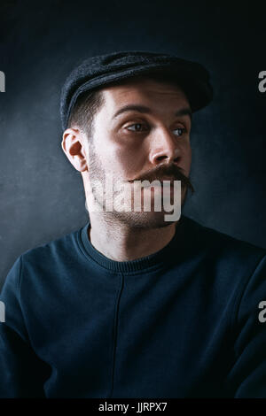 The young man in cap at studio - Stock Photo
