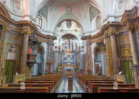 TURIN, ITALY - MARCH 16, 2017: The nave of baroque church Chiesa di Santa Maria di Piazza with the main altar by - Stock Photo