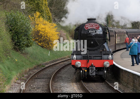 People on platform & iconic steam locomotive 60103 Flying Scotsman on tracks puffing smoke - Keighley and Worth - Stock Photo