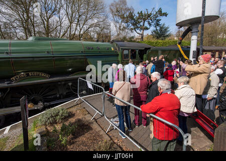 Crowd of people view iconic steam locomotive engine, LNER Class A3 60103 Flying Scotsman - Keighley and Worth Valley - Stock Photo