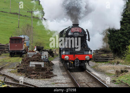 Iconic steam locomotive, LNER Class A3 60103 Flying Scotsman puffing smoke & traveling on tracks of Keighley and - Stock Photo
