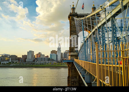 John A. Roebling Suspension Bridge with sunset and clouds at Cincinnati, Ohio. - Stock Photo