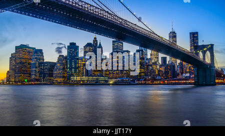 Brooklyn Bridge Park with Sunset and New York Skyline and East River - Stock Photo