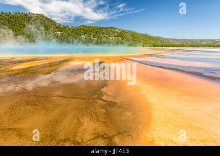 The vivid rainbow colors of the Grand Prismatic Spring in Yellowstone National Park, Wyoming - Stock Photo