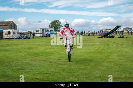Close up of Jason Smyth stuntman performing motorbike stunt at Wheels and Wings family event 2016, East Fortune, - Stock Photo