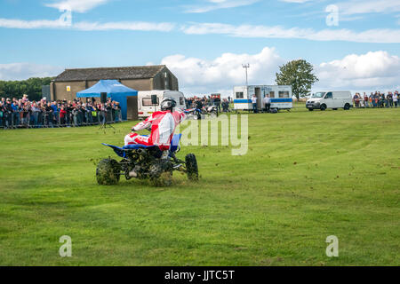 Jason Smyth stuntman performing quad bike stunt at Wheels and Wings family event 2016, East Fortune, East Lothian, - Stock Photo