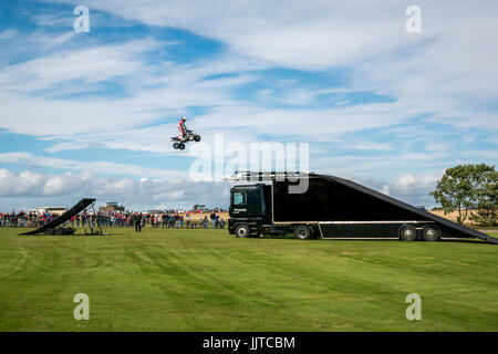 Jason Smyth stuntman performing quad bike leap stunt at Wheels and Wings family event 2016, East Fortune, East Lothian, - Stock Photo