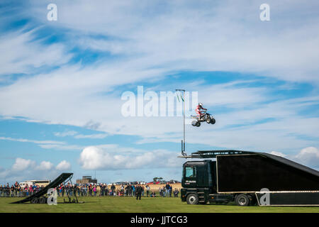 Jason Smyth stuntman performing quad bike leap stunt, Wheels and Wings family event 2016, East Fortune, East Lothian, - Stock Photo