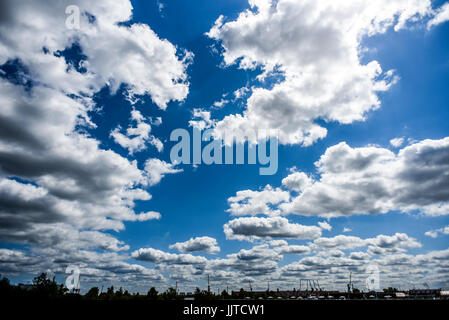 A lot of clouds in the blue sky on a summer sunny day. - Stock Photo