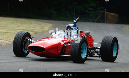 Double World Champion  John Surtees driving his champioship winning Ferrari 158 - Stock Photo