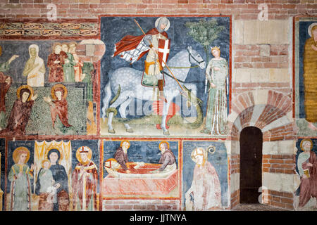 VERONA ITALY THE BASILICA DI SAN ZENO FRESCOES ON THE WALL INCLUDING ST GEORGE AND THE DRAGON - Stock Photo