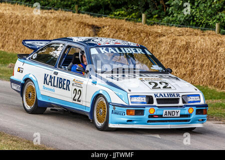 1989 Ford Sierra Cosworth RS500 touring car, BTCC Group A, with driver Andrew Brass at the 2017 Goodwood Festival - Stock Photo