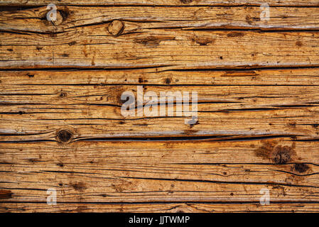 Weather worn wood texture, surface of old weathered wooden planks as background - Stock Photo
