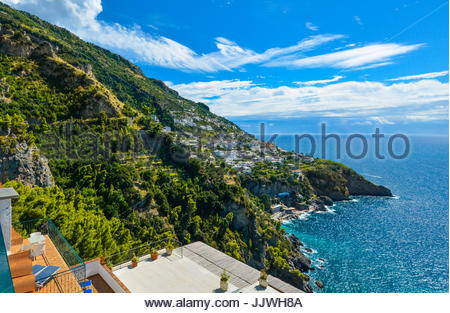 A view of a hilltop town Praiano from a scenic drive along the Amalfi Coast on the Italian Mediterranean on a warm - Stock Photo