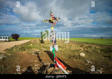 Cross on the viewpoint in 'meseta', a long stretch of plateau. Camino de Santiago. Spain, Europe. - Stock Photo