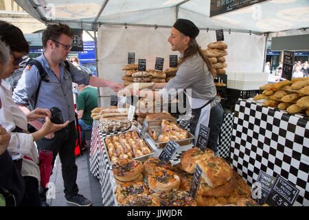 Artisan bakery stall at the Real Food Market, Kings Cross. Every Wednesday to Friday outside King's Cross Station. - Stock Photo