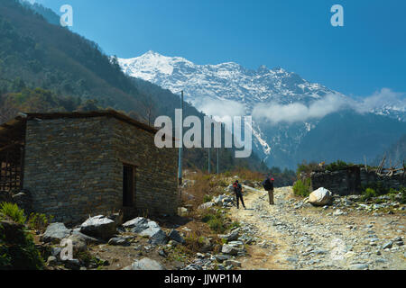 Trekking trail going through the village of Bagarchhap, Annapurna region, Nepal. - Stock Photo