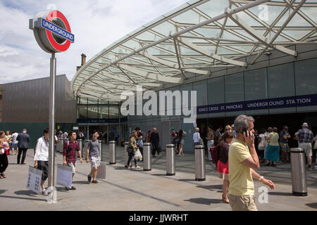 Exterior of King's Cross Underground Station - one of the entrances featuring a large roundel logo - Stock Photo