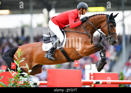 Aachen, Germany. 20th July, 2017. German show jumper Marco Kutscher riding the horse Clenur jumps over an obstacle - Stock Photo