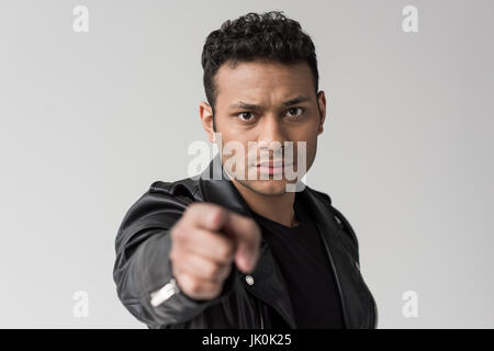 portrait of serious african american man pointing isolated on grey - Stock Photo