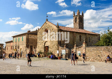 MONTERIGGIONI, ITALY - MAY 14, 2017 - People walks in the main square of the beautiful town of Monteriggioni in - Stock Photo