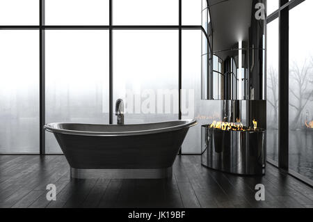 Luxury bathroom with a dark boat-shaped freestanding bathtub in front of large windows overlooking a misty winter - Stock Photo