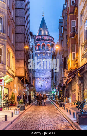 Night View of old narrow street with the Galata Tower(Turkish: Galata Kulesi)called Christ Tower by Genoese a famous - Stock Photo
