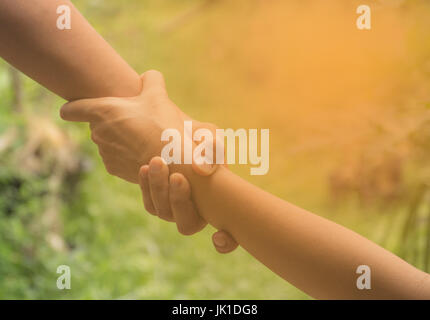 Two pairs of hand touch together, helping hands concept. Helping hand outstretched for help. - Stock Photo
