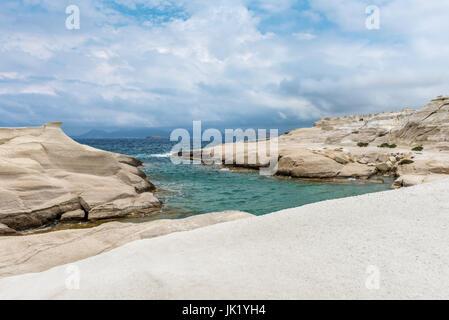 Beautiful volcanic beach with rocks in Sarakiniko on Milos island, Cyclades, Greece. - Stock Photo