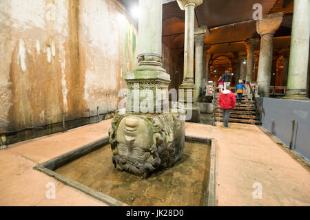 Upside down Medusa sculpture and column base. The head of Medusa was said to be turned upside down to combat the - Stock Photo