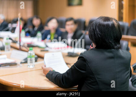 Businesswoman speaker with microphone making presentation at business conference. Business people meeting conference - Stock Photo
