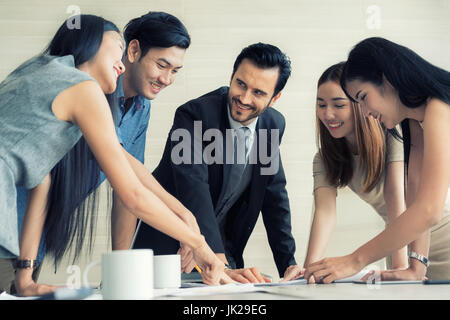 Group of multi-ethnic business partners discussing ideas in meeting room at office. Business people meeting corporate - Stock Photo