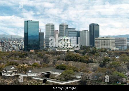 Osaka Castle with Osaka business park financial district in Osaka city, Japan - Stock Photo