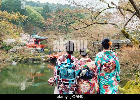 Young three girl wearing Japan kimono standing in front of Daigoji Temple in Kyoto, Japan. - Stock Photo