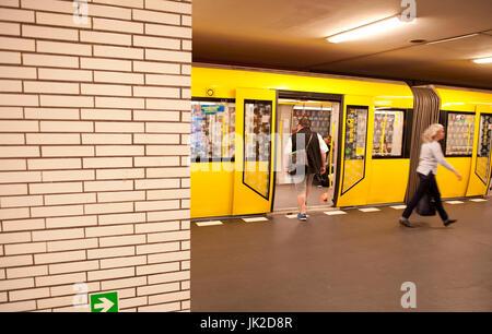 A yellow F92 train on the Berlin U-Bahn network, Germany - Stock Photo