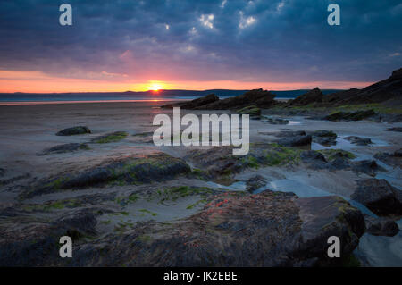 View over rock pools at sunset on Newgale beach, Pembrokeshire, Wales - Stock Photo