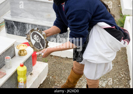 Greece, Aegean Islands, Olympos, Karpathos island,  Cleaning of the cemetery and tombs before Easter - Stock Photo