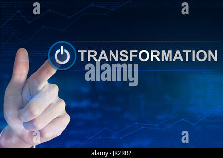 double exposure business hand clicking transformation button with blurred background - Stock Photo