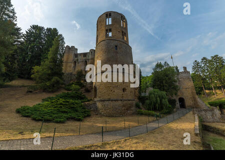 Medieval castle among trees and blue sky in Luxembourg. - Stock Photo