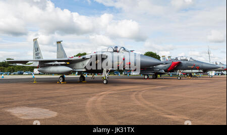 F-15E Strike Eagle sat between a pair of F-15C Eagles at the 2017 Royal International Air Tattoo at RAF Fairford. - Stock Photo