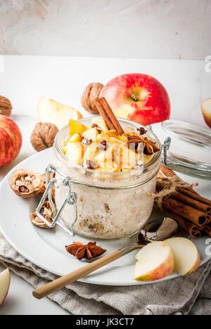Healthy vegan food. Dietary breakfast or snack. Apple pie overnight oats, with apples, yogurt, cinnamon, spices, - Stock Photo