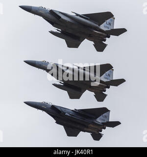 A pair of USAF F-15C Eagles seen flying in tight formation with an F-15E Strike Eagle during the 2017 Royal International - Stock Photo