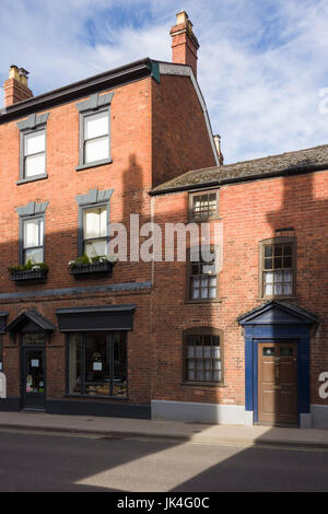 Red brick town houses in Ludlow with shadows. - Stock Photo