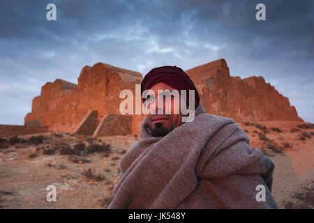 Tunisia, Ksour Area, Ksar Ouled Soltane, middle-aged Tunisian man, R, MR_TUN_10_004 - Stock Photo