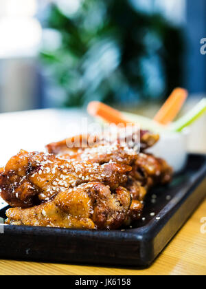Chicken wings with sesame seeds - Stock Photo