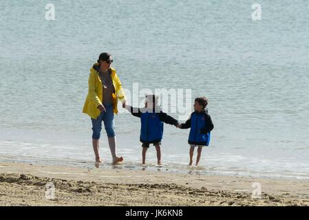 Weymouth, Dorset, UK.  23rd July 2017.   UK Weather. Holidaymakers at the beach making the most of the warm early - Stock Photo