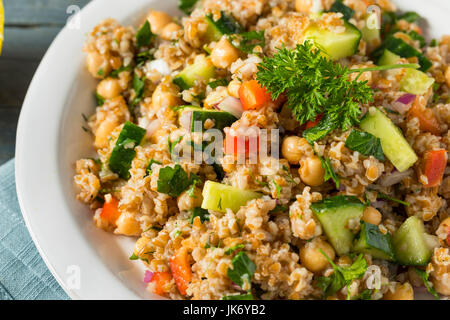 Homemade Bulgar Wheat Salad with Cucumber Parsley and Pepper - Stock Photo