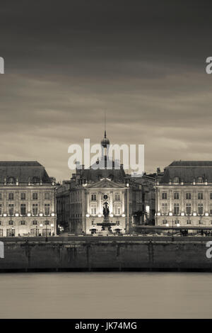 France, Aquitaine Region, Gironde Department, Bordeaux, Place de la Bourse buildings from the Garonne River, dusk - Stock Photo